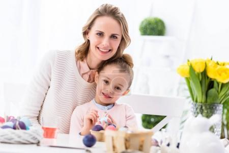 Mother and daughter celebrating with Easter eggs