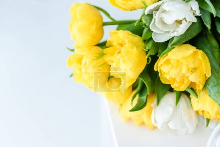 Photo for Bouquet of tender spring tulip flowers gift for 8 march on white - Royalty Free Image