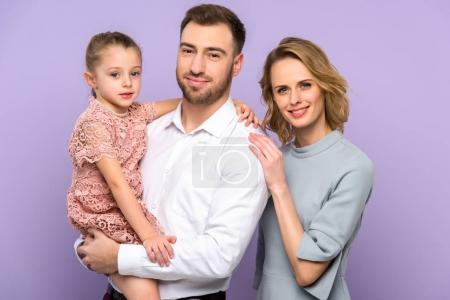 Embracing family with daughter isolated on violet