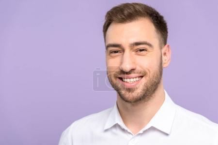 Handsome man smiling isolated on violet