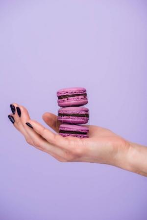 Photo for Woman holding macarons isolated on violet - Royalty Free Image