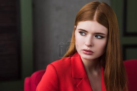 Young female fashion model dressed in red jacket