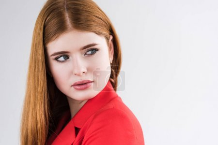 Young female fashion model with earrings isolated on grey