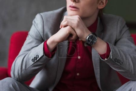 Cropped view of male fashion model with wristwatch