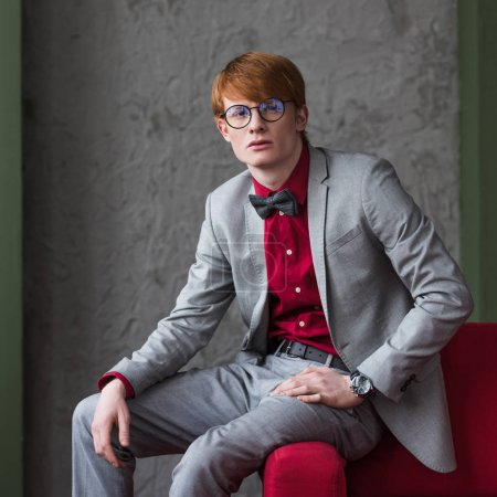 Portrait of young stylish man in eyeglasses