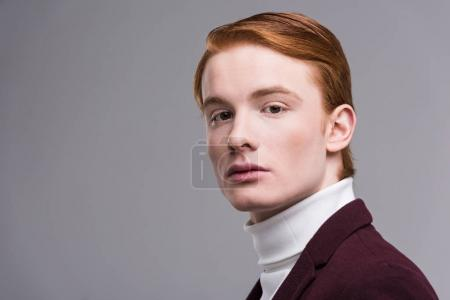 Portrait of young male fashion model isolated on grey
