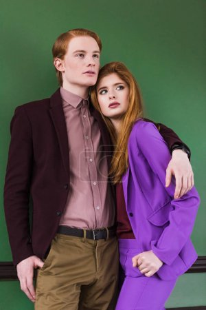 Low angle view of stylish young couple of models