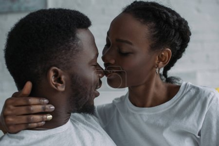 beautiful happy young african american couple able to kiss at home