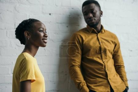 Photo for Beautiful young african american couple posing in yellow shirts - Royalty Free Image