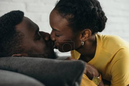close-up view of beautiful young african american couple kissing at home