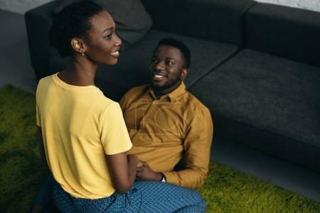high angle view of happy young african american couple in love spending time together at home