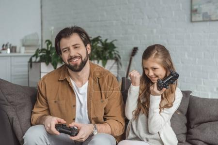 daughter winning father in video game at home