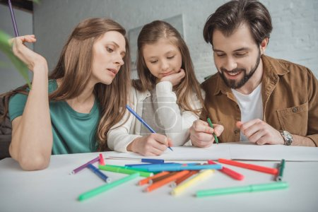 family drawing with felt-tip pens at home