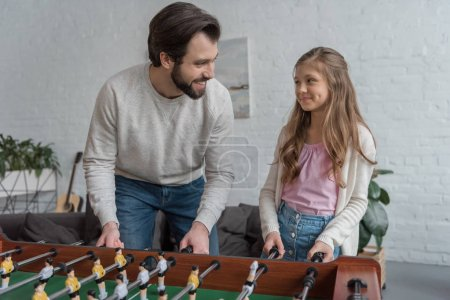 Photo for Father and daughter playing table football at home - Royalty Free Image