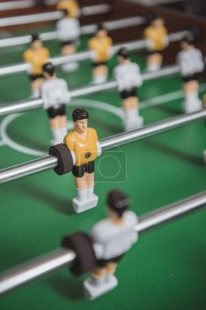 close up of table soccer with football players silhouettes