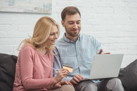 Photo for Portrait of smiling family buying goods online together - Royalty Free Image