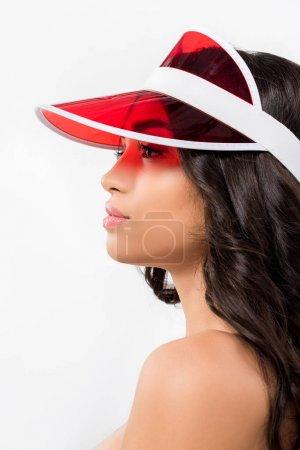 tanned brunette girl in red visor, isolated on white