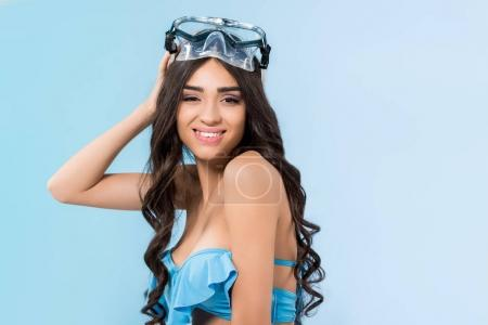 Photo for Brunette girl posing in bikini and swimming mask, isolated on blue - Royalty Free Image