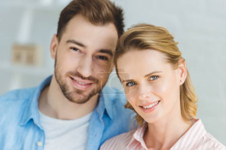 Portrait of young smiling caucasian couple