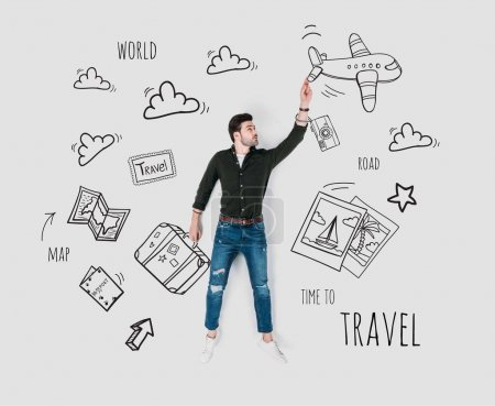 Photo for Creative hand drawn collage with man and various travel signs - Royalty Free Image