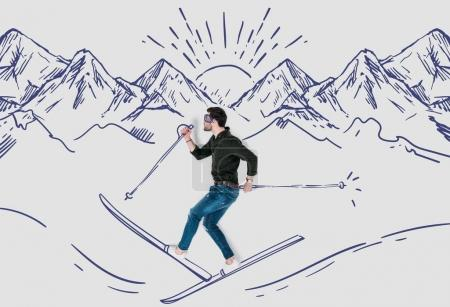 creative hand drawn collage with man skying in snowy mountains