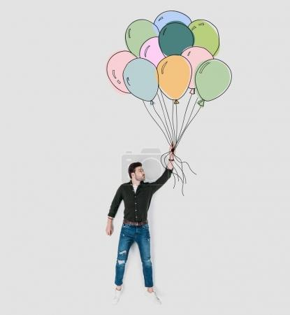 creative hand drawn collage with man holding colorful balloons