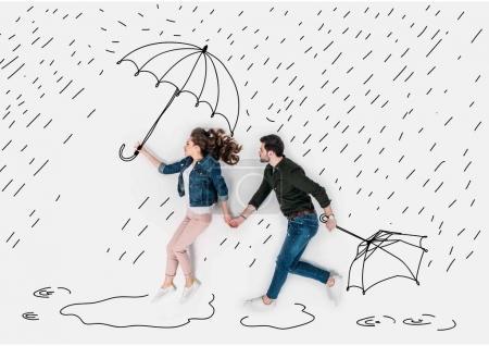 Photo pour Collage dessiné à la main créatif avec couple courant sous la pluie avec parapluies - image libre de droit