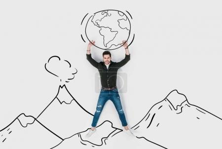 creative hand drawn collage with strong man carrying earth