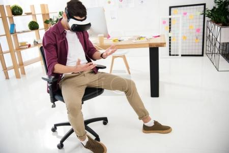 young marketing manager in virtual reality headset at workplace in office