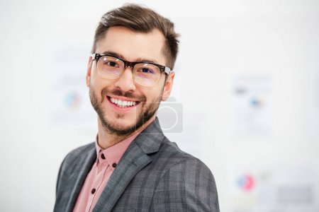 Photo for Portrait of smiling businessman in suit and eyeglasses looking at camera - Royalty Free Image