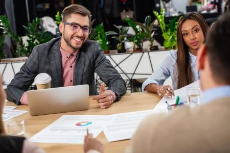 multicultural business people at workplace during business meeting with partners in office