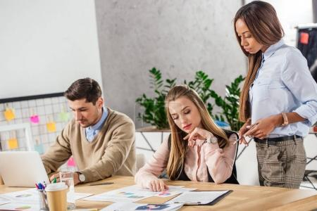 young multiethnic business people at workplace during business meeting in office