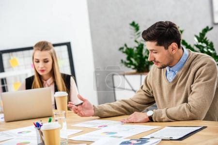 portrait of young business people at workplace during business meeting in office