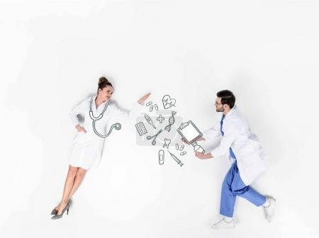 Photo for Creative collage of male and female doctors with various hand-drawn medical signs - Royalty Free Image