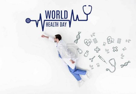 creative collage of doctor flying like super hero with world health day inscription and medical icons