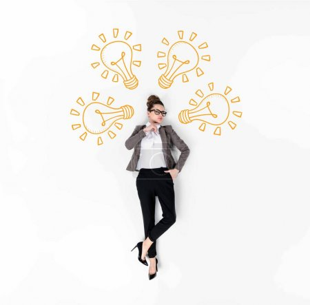 creative collage of stylish young businesswoman with drawn idea light bulbs