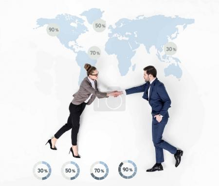 creative collage of business partners shaking hands against world statistics map