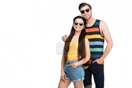 couple in sunglasses hugging isolated on white