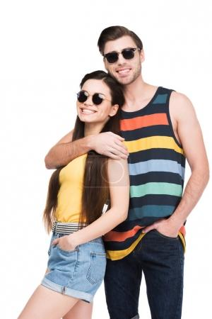 man in sunglasses embracing his girlfriend, isolated on white