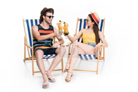 couple relaxing and clinking glasses with summer cocktails, isolated on white