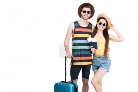 happy travelers with passports, air tickets and baggage, isolated on white