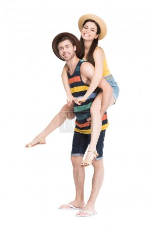 Photo for Smiling man piggybacking his beautiful girlfriend, isolated on white - Royalty Free Image