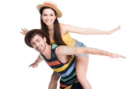 Foto de Feliz novio piggybacking su novia alegre, aislada en blanco - Imagen libre de derechos