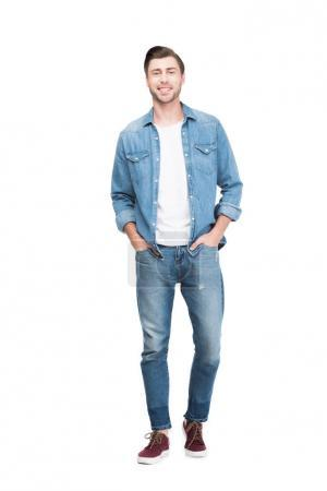young smiling man in jeans looking at camera, isolated on white