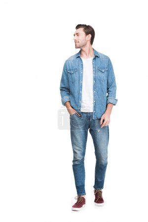 young smiling man in jeans, isolated on white