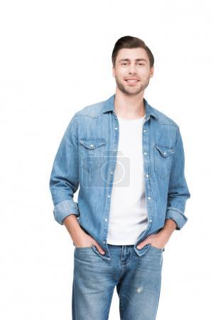 handsome smiling man in jeans looking at camera, isolated on white