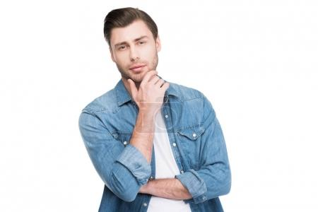 portrait of thoughtful handsome man looking at camera, isolated on white