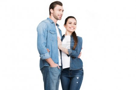 young couple in jeans embracing isolated on white