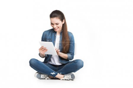 attractive smiling woman using digital tablet, isolated on white