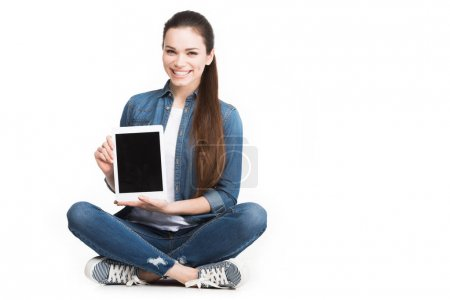attractive smiling woman showing tablet with blank screen, isolated on white